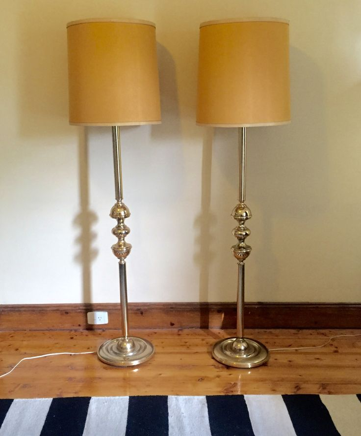 PAIR OF MID-CENTURY GOLD FLOOR LAMPS - $350 AUD  This matching set of Mid-century gold floor lamps come with their original shades in good working order.  Would look quite regal on either side of a feature sofa.