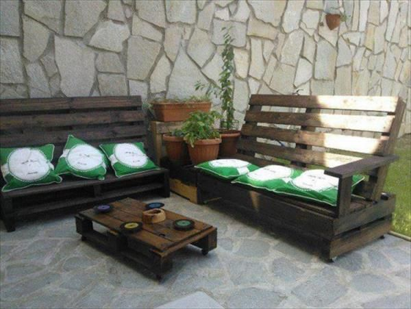 This is a set of the pallet wooden benches s and table which is place on the side of the lawn outdoor. You can see that on the berth section cushions are placed to make it comfort and the table are small in size but you can easily take your coffee and food on it.