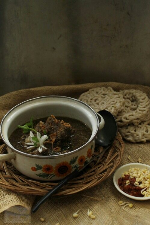 """Rawon Iga. Indonesia's black ribs soup. The color comes from fermented poisonous fruit called """"keluwak"""" or Pangium edule. Trust me, it is so yummy for your tummy. Served hot."""