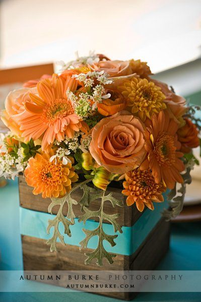 I like the idea of using a colored ribbon around the wooden box.  Not crazy about the colors of the flowers themselves.