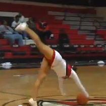 WATCH: College cheerleader nails half-court trick shot. AMAZING!!