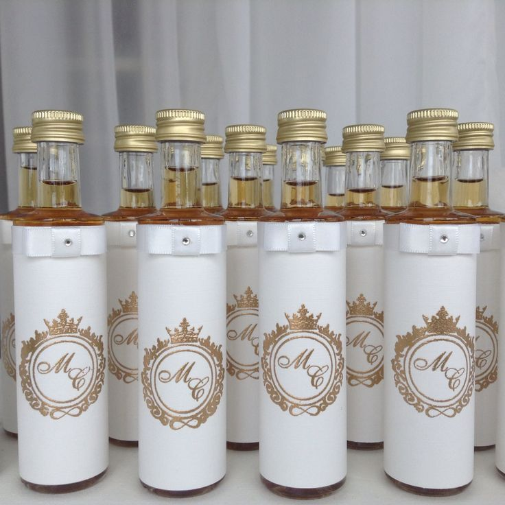 Bottled whiskey with embossed gold wedding logo