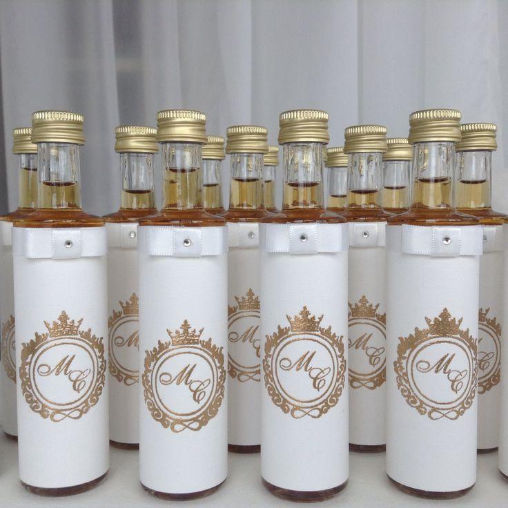 Bottled whiskey with embossed gold wedding logo