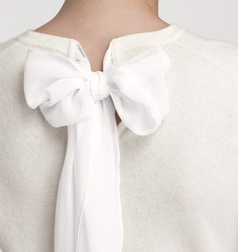inspiration...simple enough to do..take a beautiful simple sweater, create a slit in the back and add lovely linen or chiffon to form an elegant bow