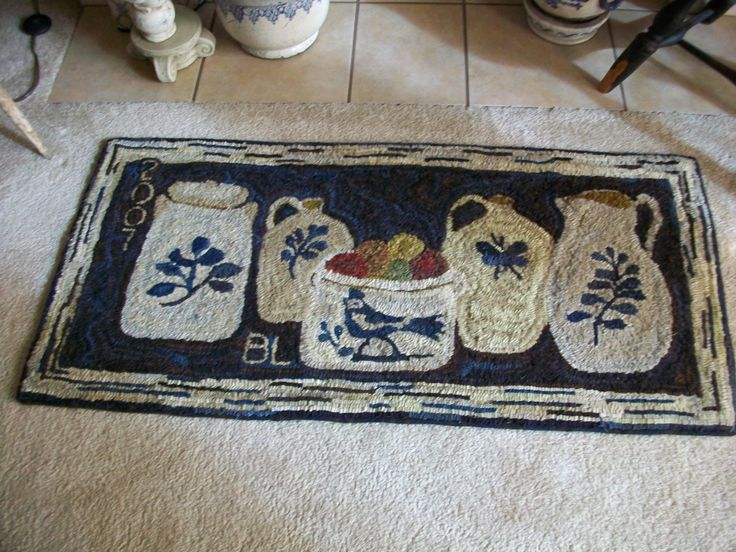 Primitive hooked rug with crocks designed by Bonnie.