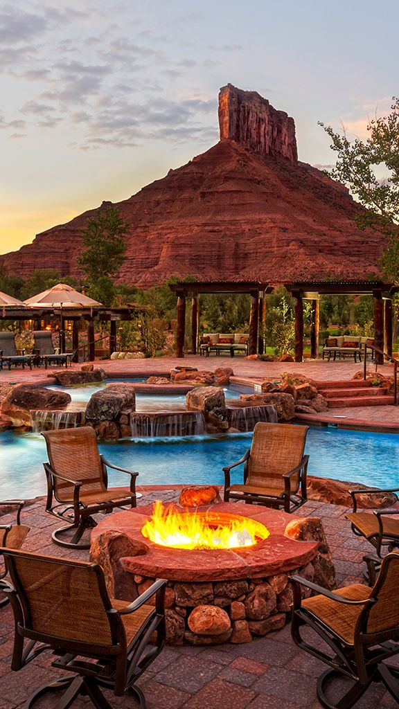 Cozy up by the outdoor fire pit after an afternoon of swimming. #Colorado