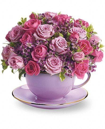 tea cup full of flowers