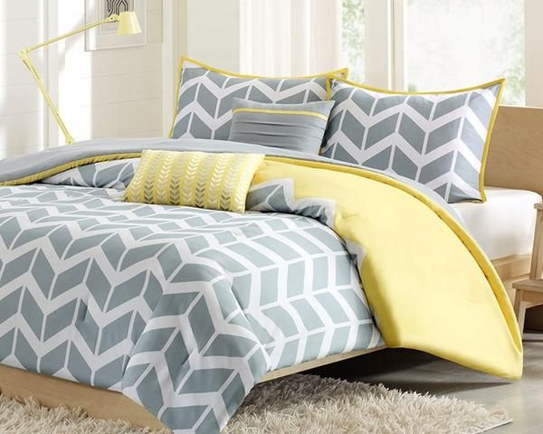 """Chevron makes any bedroom fun and inviting. The comforter features a fresh solid color with a gray and white chevron print that runs along the bottom broken up by white vertical stripes. The shams feature the coordinating gray and white chevron pattern with a coordinate flange. The comforter and sham reverses to a solid gray color. The set comes with two coordinating decorative pillows. One toss pillow is square at 16"""" and the second is a boudoir measuring 12x18""""."""