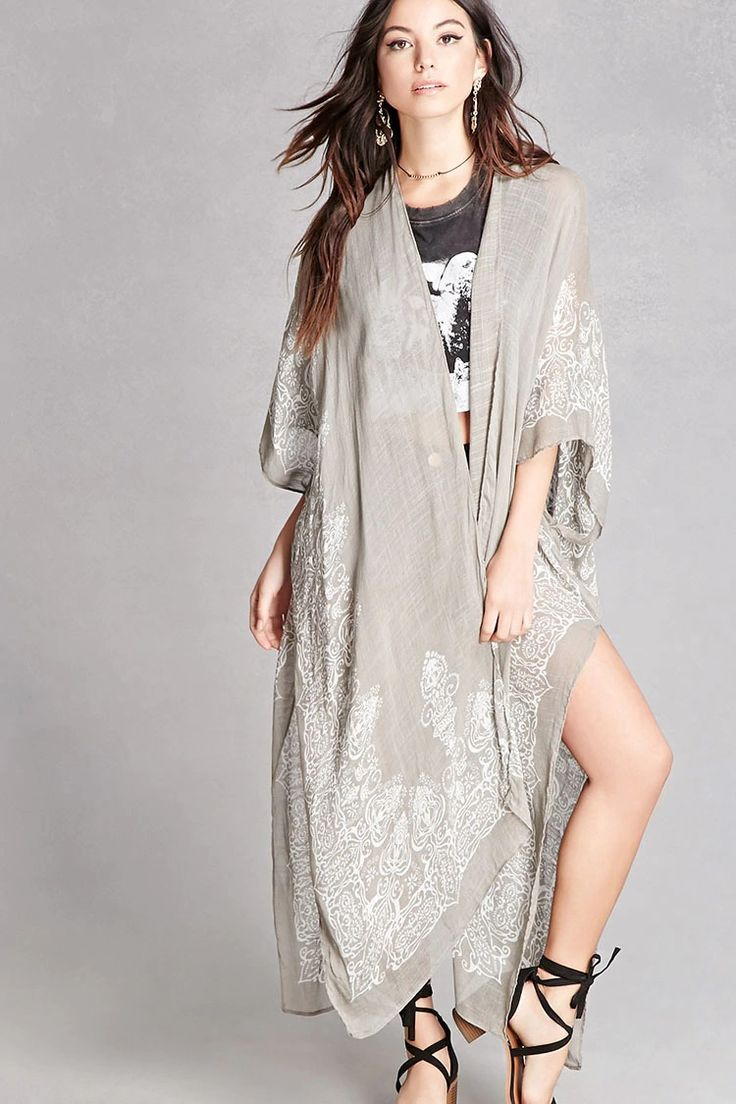 A semi-sheer woven kimono featuring a contrasting ornate printed trim, an open-front, short dolman sleeves, a crescent hem, and split sides. This is an independent brand and not a Forever 21 branded item.