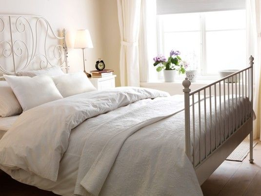 Ikea Leirvik bed, white bedding, white walls, white curtains. Beautiful and calming.