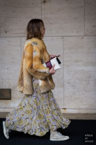 Emma Morrison wearing fur jacket, a Burberry dress and Rochas clutch before Lacoste fashion show. STYLE DU MONDE on Instagram @styledumonde, Pinterest, Twitter, Tumblr and Facebook