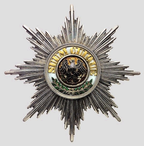"Medal of the Order of the Black Eagle, with the motto ""SUUM CUIQUE"" in the center."