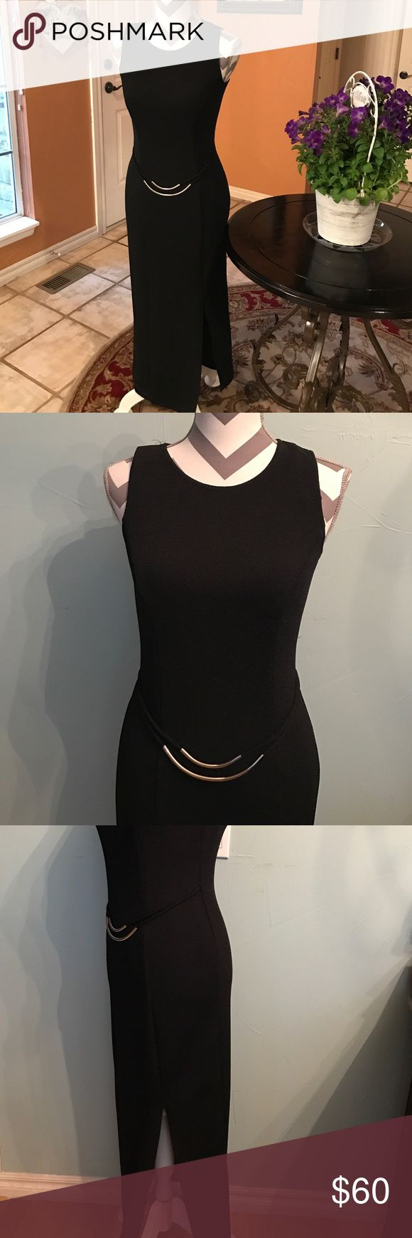 🆕 Maxi black sleeveless Scarlett dress 🆕 Maxi black sleeveless Scarlett dress              With gold accent in waist                                             Length 50 inches; with slit the length of slit 17 inches; bust line 32 inches NO TRADE! Kindly check more Bags, Shoes,tops,skirts,dress etc. Waiting for you!  Perfect condition!!!! Scarlett Dresses Maxi