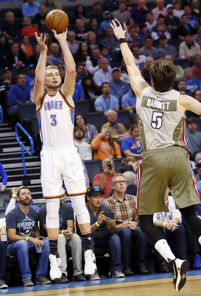 Oklahoma City's Domantas Sabonis (3) shoots against Miami's Luke Babbitt (5) during an NBA basketball game between the Oklahoma City Thunder and the Miami Heat at Chesapeake Energy Arena in Oklahoma City, Monday, Nov. 7, 2016. Photo by Nate Billings, The Oklahoman