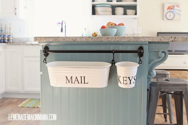 Organization: Charming containers for 'Mail' & 'Keys' hanging from a rod on the side of the kitchen island helps to keep everything in its place.