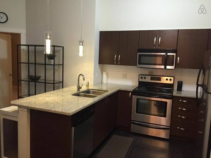 Condominium in Surrey, Canada. Clean and Comfortable. Excellent location across from SkyTrain! Hardwoods, 2 bedrooms and 2 full bath, balcony, modern kitchen with ss appliances, granite countertops, on top floor, high ceilings, all nice cooking essentials, new plush towels Cabl...