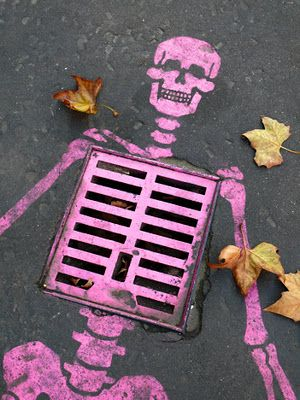 Pink skeleton, stenciled on a street in Paris. - wouldn't this be fun to do around town for Halloween?