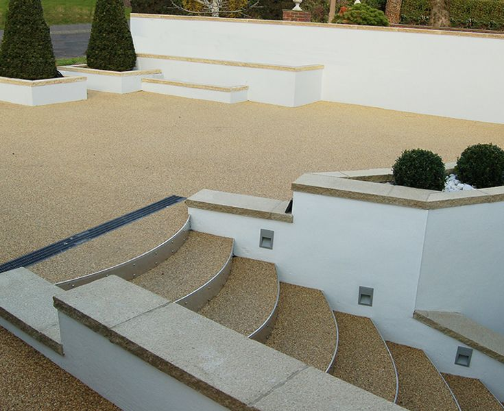 Clearstone's Resin Bound Gravel is flexible and versatile. Stainless steel risers on steps approaching the front door of a contemporary new build, created a sleek modern look.