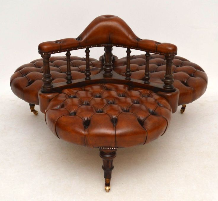 Extremely Rare Antique Early Victorian deep buttoned leather 'Conversation Sofa', dating from around the 1840-60 period, in good condition.