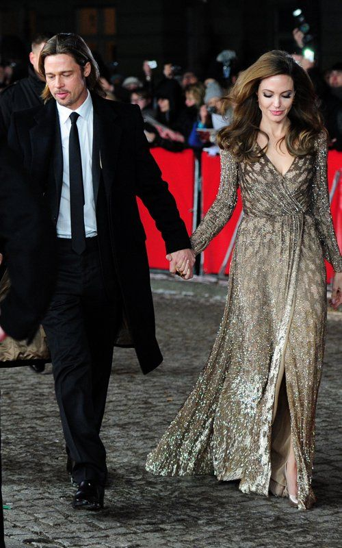 I've been staring at this photo for a while now and still can't get over how regal Angelina looks here. The hair, the dress!!! #perfection
