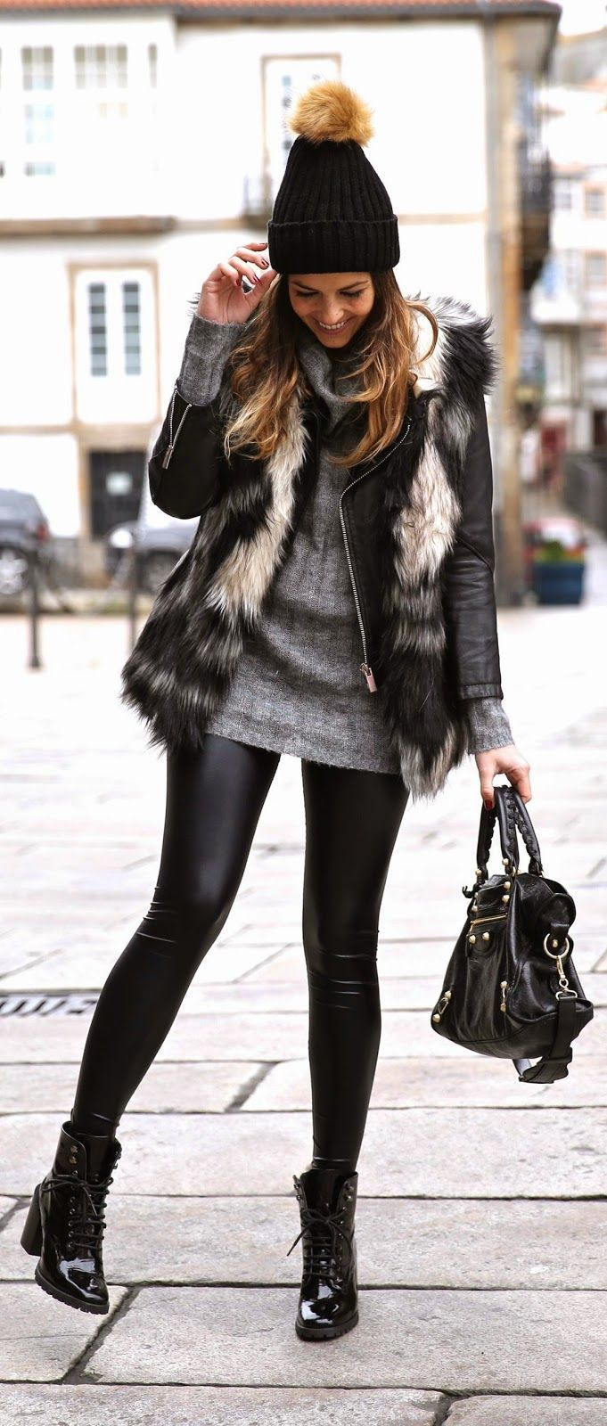 Ad. Black pom pom beanie  Great winter outfit!  leather leggings. Fur vest.