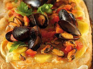 La Pizza Integrale al sapore di Tiella Barese una pizza dal sapore Mediterraneo che unisce terra e mare. La Pizza Integrale al sapore di Tiella Barese è una ricetta facile per tutti quelli che voglion