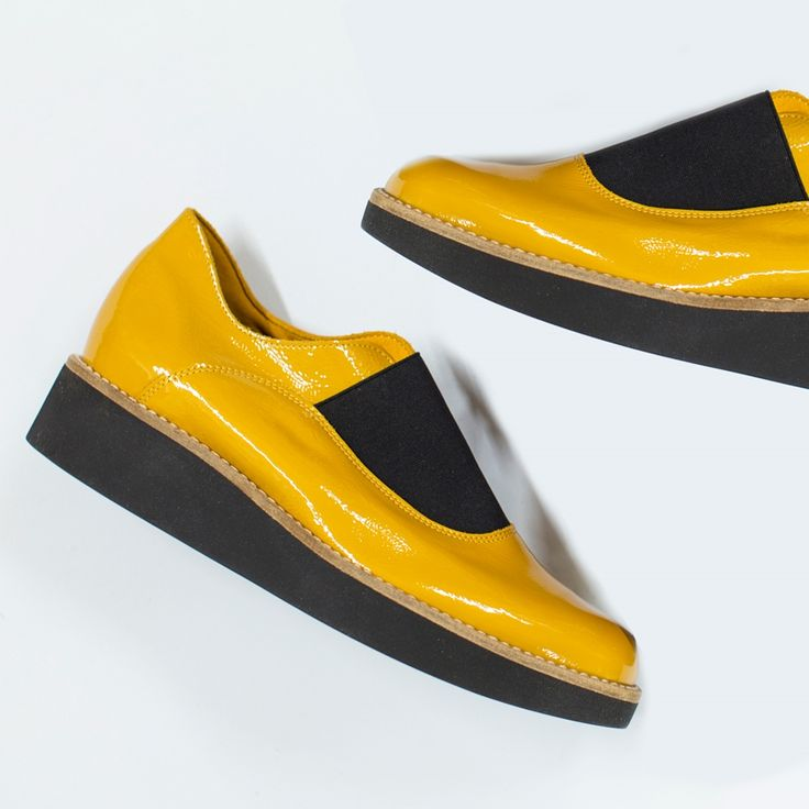 Platforms are hot for 2016 and the Darum by Arche is no exception. An easy slip-on style with elastic panel and Arche's signature shock absorbing sole. Available in mustard yellow patent or black patent with black platform wedge sole. Made in France.