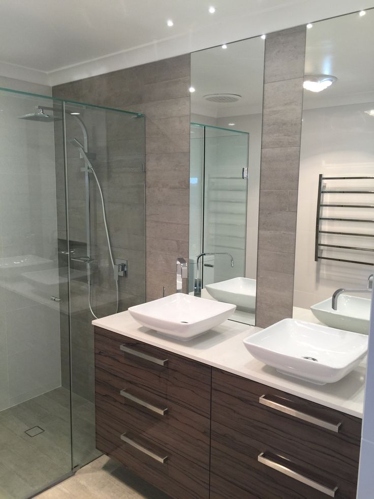 A modern touch is added to the bathroom with the client's choice of quality, squareline tapware, showerhead, cabinet handles and a heated towel rail.