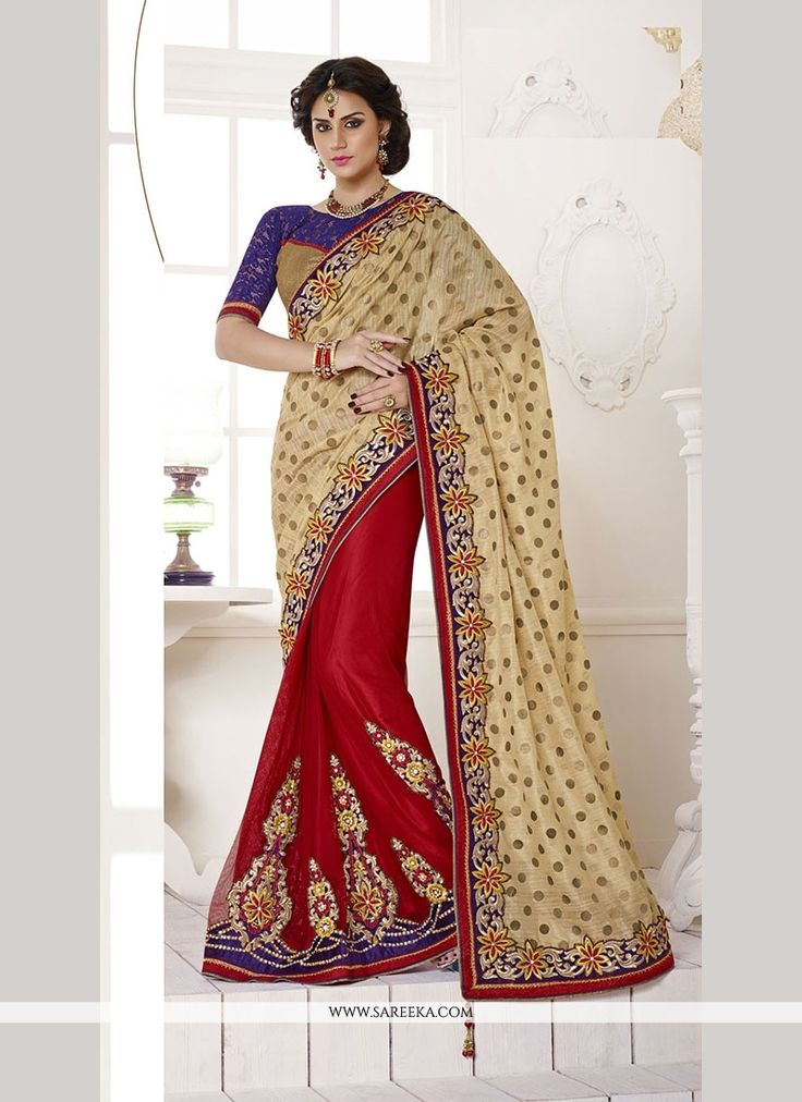 Ravishing attire to enhance your beauty. Make an adorable statement in this smashy red art silk and bhagalpuri silk classic designer saree. The embroidered and patch border work looks chic and perfect...