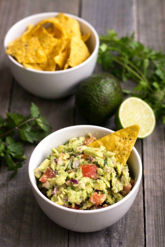 People will gather around this healthy guacamole recipe at your next party. This delicious, filling appetizer is addictive even though it's super healthy! It's the only guac recipe you'll ever need.