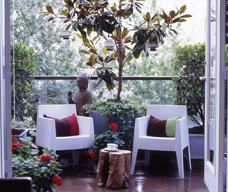 Modern Asian Balcony ~ Trees, lanterns and sleek furniture create a hotel-style balcony. ~ This compact condo balcony was transformed into a tranquil garden oasis with Asian flair. White Philippe Starck chairs add a modern edge, but don't take up too much floor space. A tree stump is just the right size for a couple of drinks.