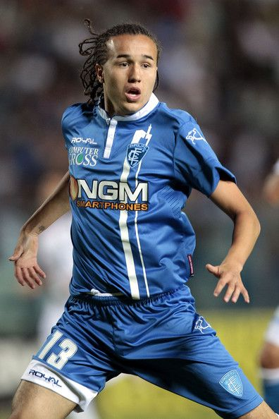 Diego Laxalt Photos Photos - Diego Laxalt of Empoli FC in action during the TIM Cup match between Empoli FC and L'Aquila Calcio at Stadio Carlo Castellani on August 24, 2014 in Empoli, Italy. - Empoli FC v L'Aquila Calcio