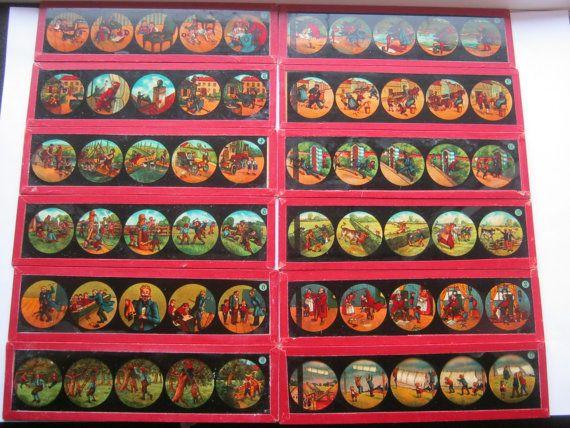 Originele toverlantaarn twaalf glijdt. Totaal van zestig beelden - van Grimm sprookjes uit rood vak serie - ca 1910  Twaalf dia's voor een totaal van zestig kleurenafbeeldingen die werden gemaakt om te worden gebruikt met een toverlantaarn.Elke dia heeft vijf foto's beeltenis van de sprookjes van Grimm's. Gemaakt omstreeks 1910Afmeting: lengte 18 cm breedte 5 cmVoorwaarde - goed.Compleet met enkele originele verpakking.Veilig gemaild.  EUR 5.00  Meer informatie