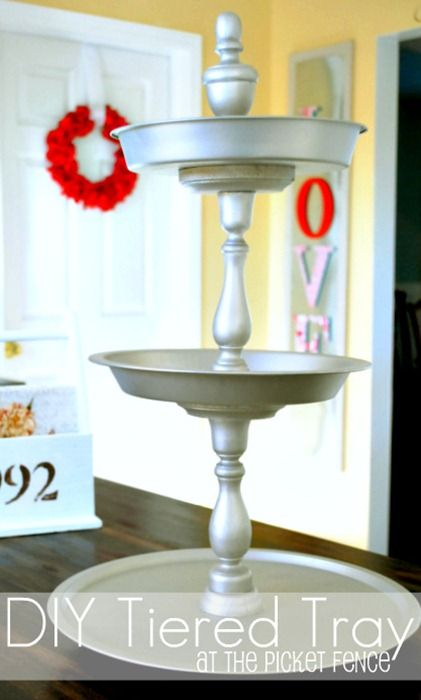 DIY three tiered tray from At The Picket Fence using Dollar Tree trays.