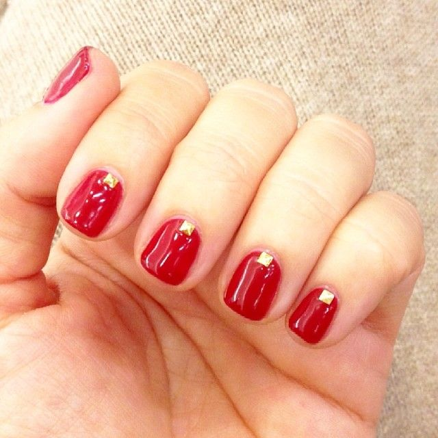 Gold studded red calgel nail art (manicure by Sharon at Sakura NYC)