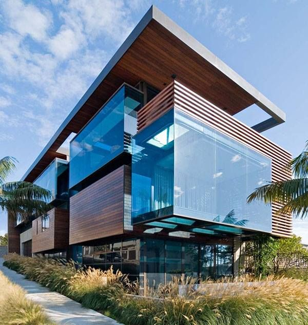 "The Ettley Residence is an incredible beach house designed by architects Studio 9 one 2 in Los Angeles, California.  The Aluminium and wood ""umbrella"" sits over blue glass blocks, which appear like cubes of frozen blue Pacific ocean. For a similar warm, deep colour to the wood on this home, try sustainable and durable Kebony SYP!  Image credit: onekindesign.com"