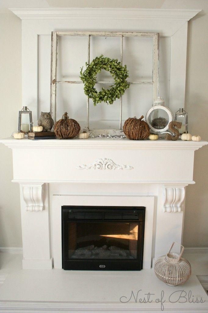 fall autumn fireplace mantel Love the window pane, wrapped letter & vine pumpkins.