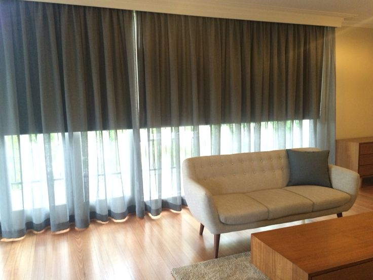 Dark roller blinds & sheer curtains.