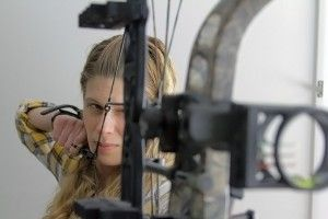 Kristen Schmitt shoots her bow and gives archery tips from her first time at an indoor archery range.