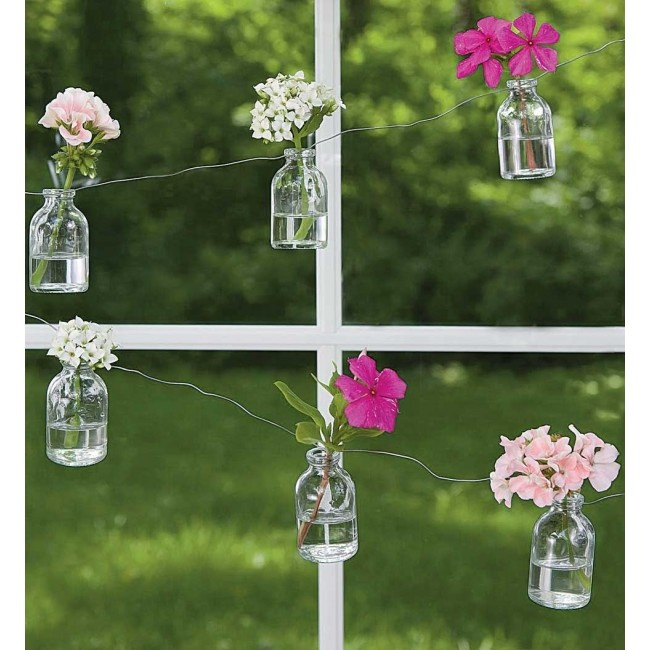 I love the look of this Bottle Garland strung on wire, from Vivaterra.  Hip Hostess: Gaga for Garden Gear