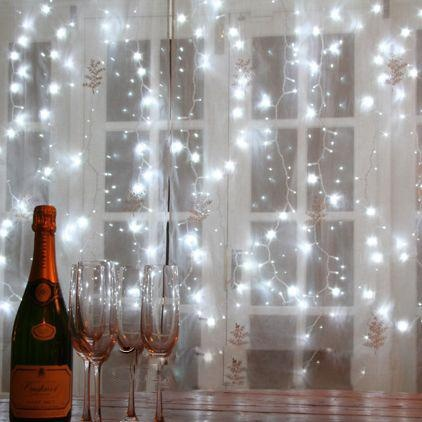 Romantic/lovely star-burst windows! Hang LED sting lights behind a sheer soft curtain for this ...
