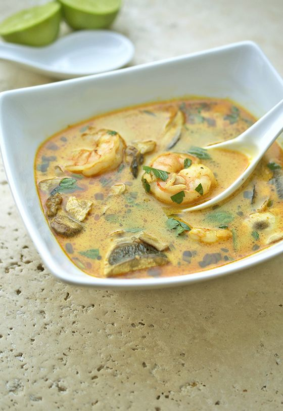 Thai Coconut Soup. This soup is spicy thanks to the curry paste and sweet from the coconut milk. Loaded with vegetables, shrimp and garnished with fresh cilantro and lime. A one pot dish that can be made in less than 30 minutes! | chefsavvy.com #recipe #thai #curry