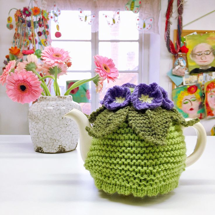 """Want to improve your #Knitting?  Perhaps you can """"knit"""" already (and have quite a few scarves ;-)) but you want to move on!?   Then this is the course for you... Come to our inspiring #studio above our shop """"The Fluff-a-torium"""" in #Dorking, and learn to increase; decrease; shape; follow a pattern; and make this Spring-like pretty #TeaCosy with sweet #knitted #flowers in the process!  #course #class #improvers #gilliangladrag"""