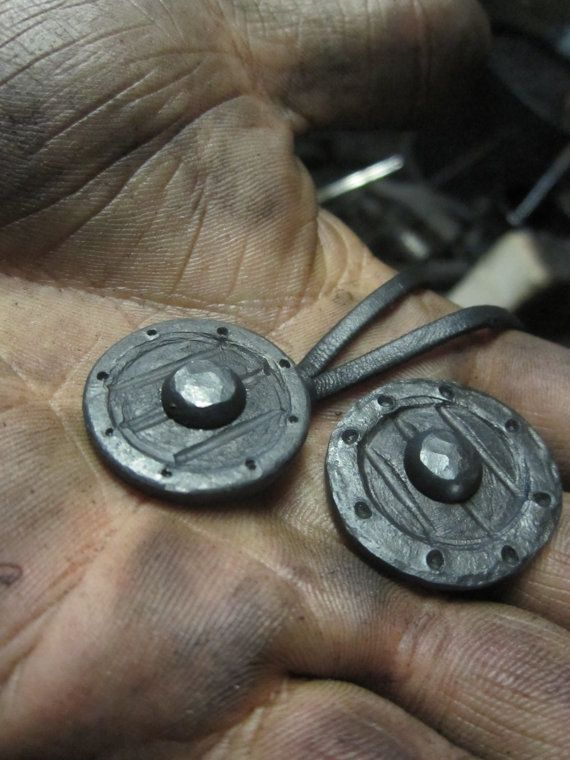 A hand forged Viking shield pendant. Comes supplied by Routarauta