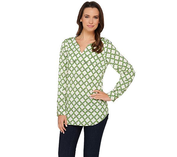 An allover trellis print lends a luxurious look to this C. Wonder blouse…
