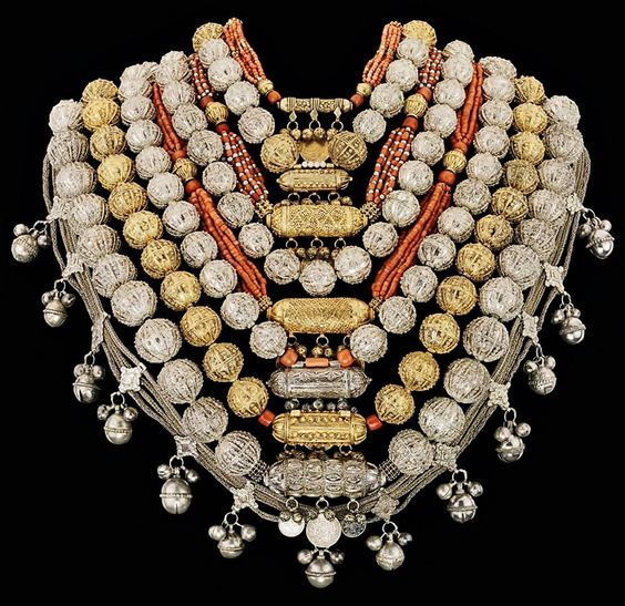 Bridal jewellery. For a Jewish workshop in Sana'a (Yemen), 1930s–1940s. Silver and gilt-silver filigree and granulation, corals, coins. (© The Israel Museum, Jerusalem).: