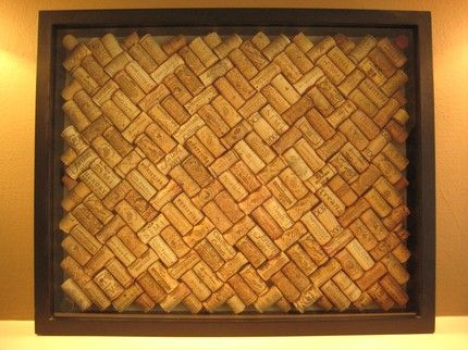MAKE THIS!!! Wine cork board! Create your own pattern in old frame & glue the backs!