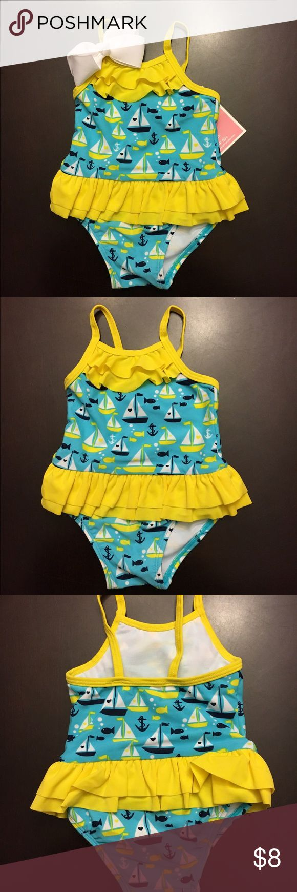 """🎀NWT One-Piece Swimsuit """"Sailboats"""" - 9 Months Brand new with tags One Piece Swimsuit - Sailboats print. The hair bow is not included with the swimsuit. Size 9 months. Perfect for your little water bug!! Circo Swim One Piece"""
