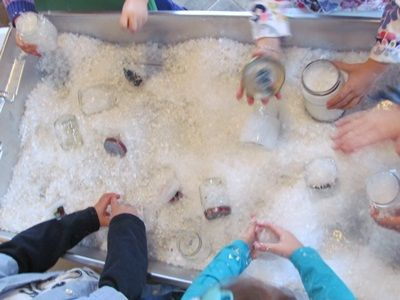 snow sensory tub, fake snow, small jars with lids, pine cones, evergreen stuff, arctic and penguin toob