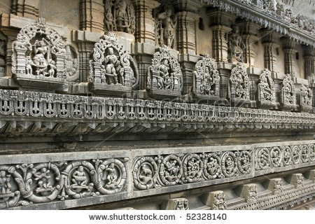 stock photo : layered carvings around the famous ancient belur temple in karnataka state, india. Construction of the Chenna Keshava Hindu temple began in 1116 AD, and took more than 100 years to complete.  Image ID: 52328140
